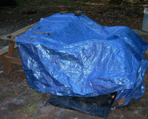 Tarp covering tent set up - www.Motorcycles123.com