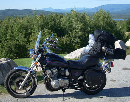 Suzuki motorcycle with camping gear - www.MotorCycles123.com